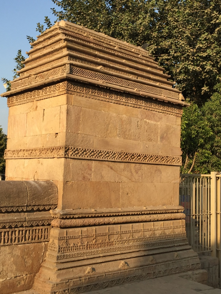 adalaj - intricate designs in outside entrance pillar