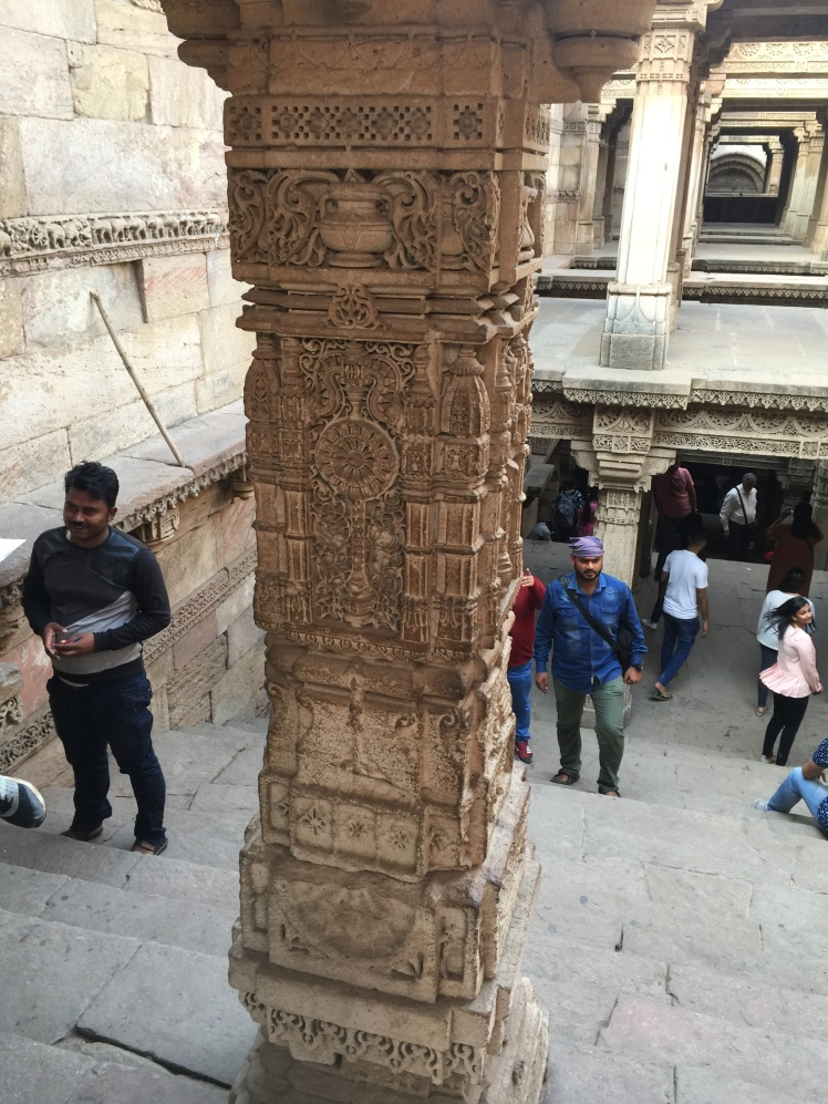 adalaj - intricate pillar in below ground level basement